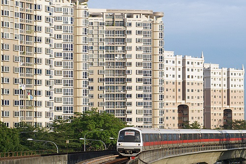 MRT train passing by executive condominiums