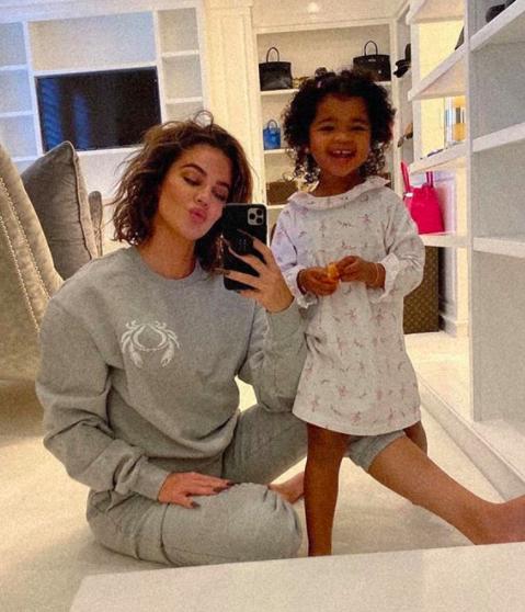 Khloe Kardashian posed with her daughter True wearing Good American sweatsuit